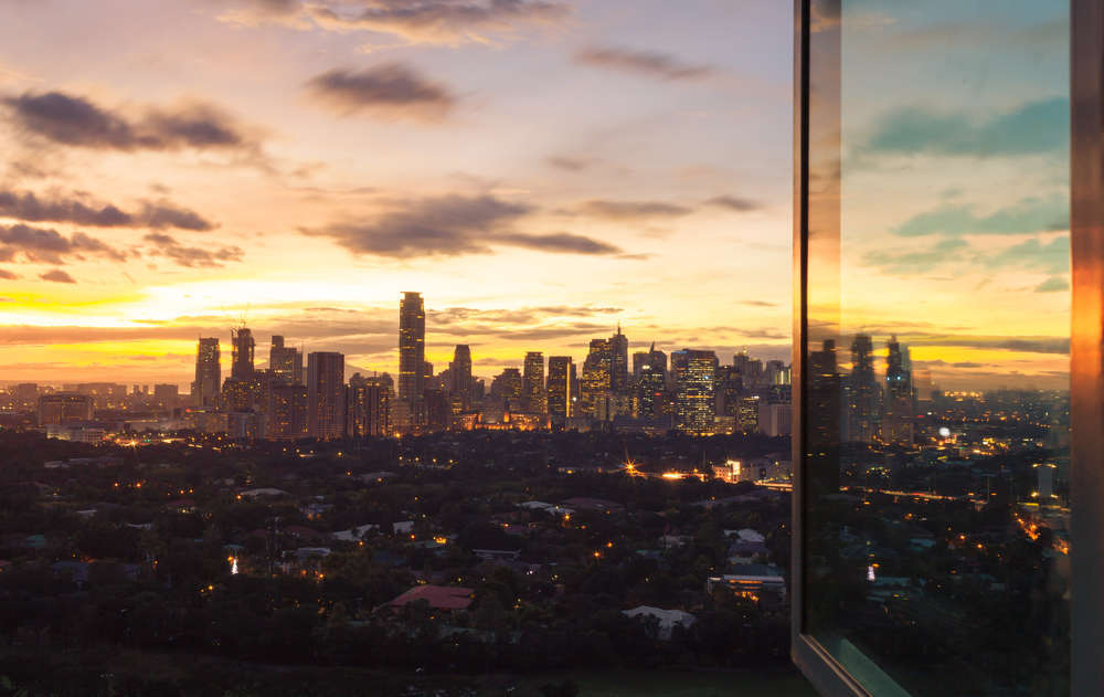 The famous Manila sunset from the window of a high-rise building. KieferPix/Shutterstock