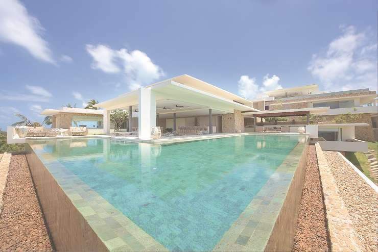 Sitting at the highest point of the estate, the villa's infinity pool offers unparalleled views of the island and ocean