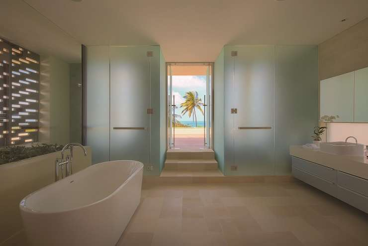 State-of-the-art fittings including rain showers and oversized bathtubs are present in the nine bathrooms within the villa