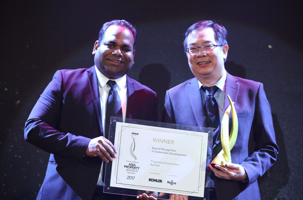 File photo: Sheldon Fernandez, country manager at PropertyGuru.com.my, the official portal partner of the Awards, presents Tropicana Corporation Berhad one of its 8 trophies at the 2017 gala dinner