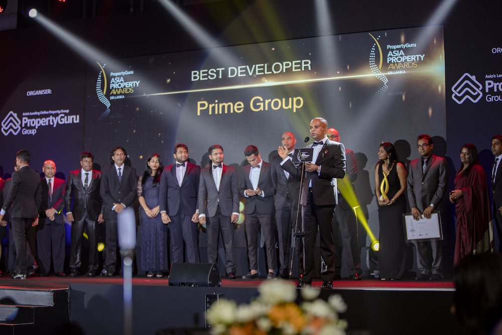 Prime Group chairman Premalal Brahmanage calls his team on stage as he finishes his acceptance speech for Best Developer at the PropertyGuru Asia Property Awards (Sri Lanka) 2018 gala dinner in Colombo