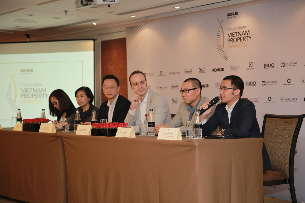 Nguyễn Trung Kiên, Hanoi Branch Manager for An Cuong Wood Working Joint Stock Company (rightmost) talks to the press at the launch of the nominations round of the 2019 PropertyGuru Vietnam Property Awards. Seated to his left was Hoang Van Quyen, Country Manager, Kitchen & Bath for Kohler Vietnam