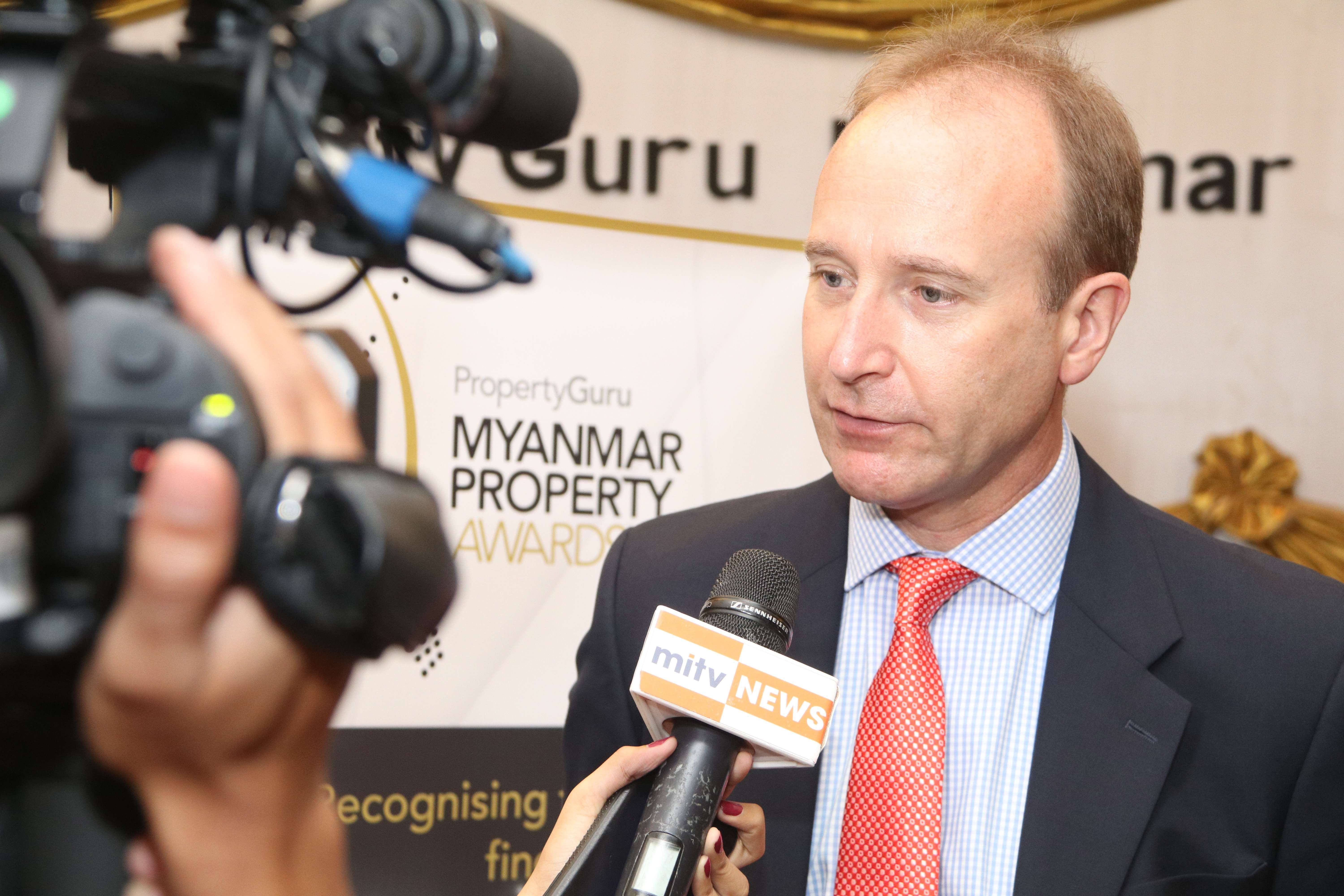 Richard Emerson, incumbent chairman of the PropertyGuru Myanmar Property Awards, talks to local media after the launch of the 2018 competition in Yangon