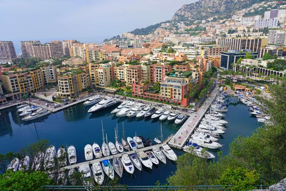 View of boats in the Port de Fontvieille harbor at the foot of the Rock of Monaco. EQRoy/Shutterstock