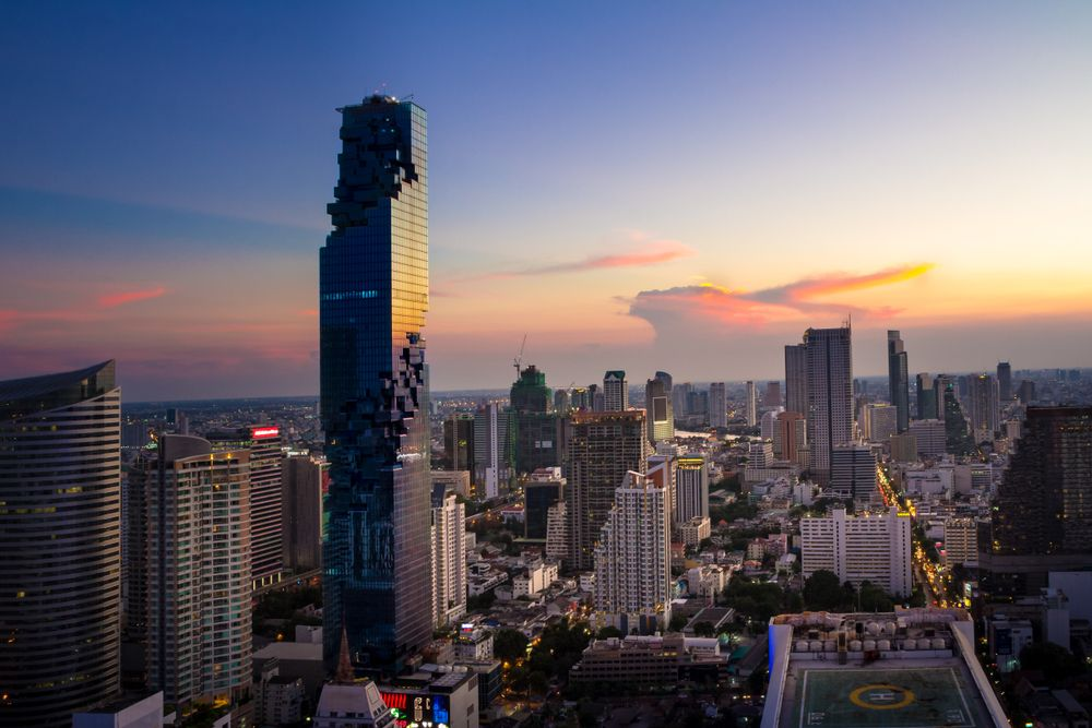 Skyline of Bangkok dominated by the MahaNakhon skyscraper, home to The Ritz-Carlton Residences. Kumpol Chuansakul/Shutterstock