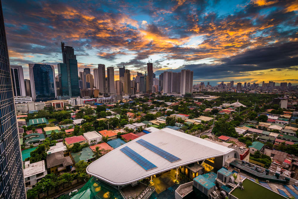 View of the skyline of the Makati financial district and surrounding villages at sunset. ESB Professional/Shutterstock