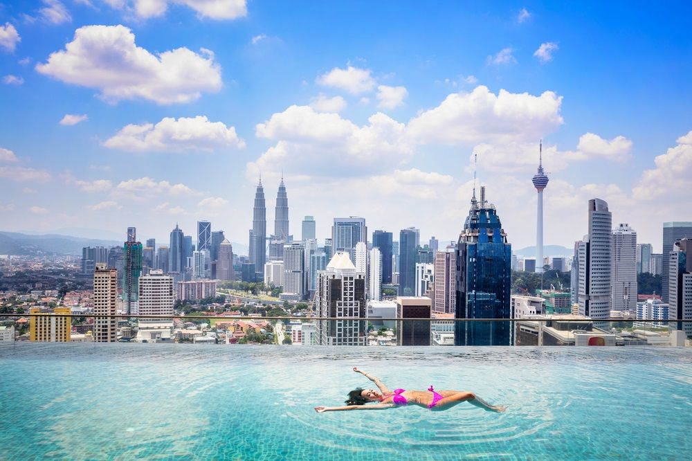 Luxury condo projects in Kuala Lumpur, Malaysia often feature an infinity sky pool. Patrick Foto/Shutterstock