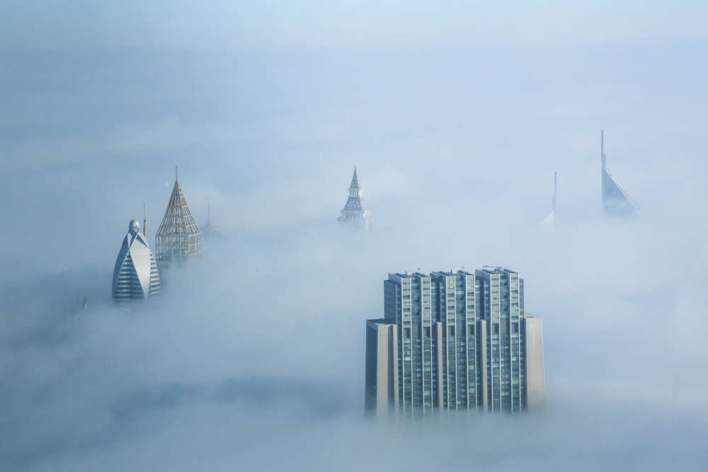 View from the top of the Burj Khalifa in Dubai, the world's highest building, on a foggy morning. artartty/Shutterstock
