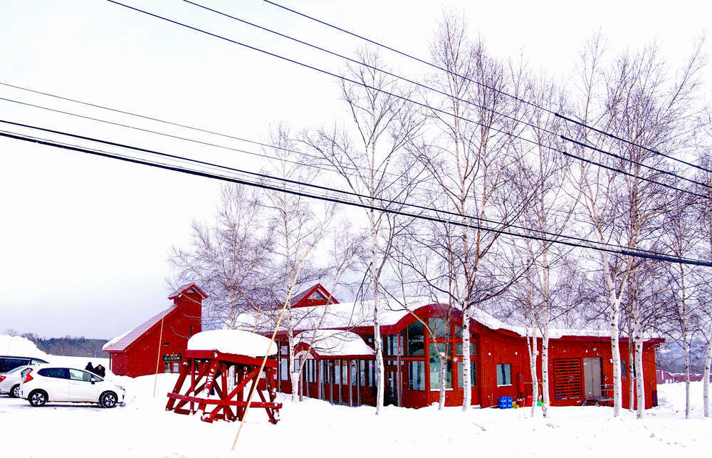 External view of Niseko Milk Kobo, Hokkaido, Japan during winter season. George Yong/Shutterstock