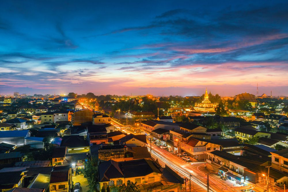 Night over downtown Vientiane, Laos. OULAILAX NAKHONE/Shutterstock